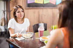 Couple of women talking over lunch Stock Image