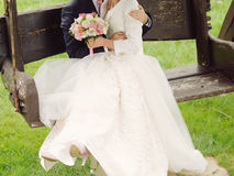 Couple on Wooden Bench Stock Images