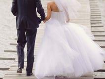 Couple on Wooden Bridge Royalty Free Stock Photo