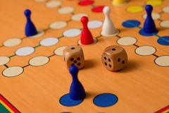 Couple of wooden dices on Ludo board Royalty Free Stock Photography