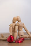 A couple of wooden doll man with heart-shaped chocolate Royalty Free Stock Images