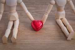 A couple of wooden doll man on valentine days showing love to each other Royalty Free Stock Images