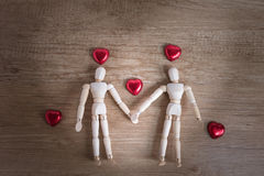 A couple of wooden doll man on valentine days showing love to each other Stock Images