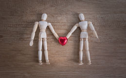 A couple of wooden doll man on valentine days showing love to each other Royalty Free Stock Photography