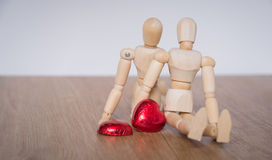 A couple of wooden doll man on valentine days showing love to each othere Stock Photography