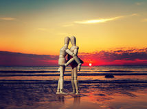 Couple of wooden figures hugging Stock Photography