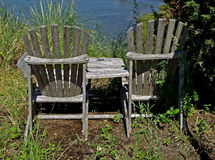 A couple of wooden garden chairs Stock Images