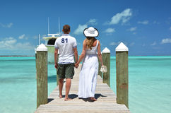 Couple on a wooden jetty Stock Image