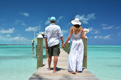 Couple on a wooden jetty Stock Images