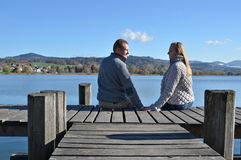 A couple on the wooden jetty Royalty Free Stock Image