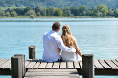 A couple on the wooden jetty Royalty Free Stock Images