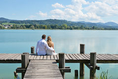 A couple on the wooden jetty Stock Images