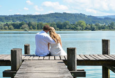 A couple on the wooden jetty Royalty Free Stock Photography