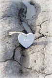 Couple of wooden love hearts on the sand bank Stock Photo