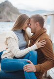 Couple on wooden pier near the sea in autumn Royalty Free Stock Images
