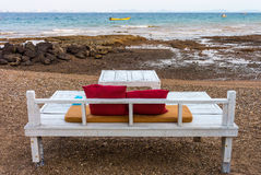 A couple wooden seat for spouse or family on sand beach. The beach is on Ko Lan island in Thailand Royalty Free Stock Image