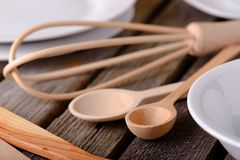 Couple of wooden spoons on a table Royalty Free Stock Photos