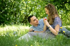 Couple in the woods blow bubbles Royalty Free Stock Image
