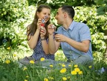 Couple in the woods blow bubbles Royalty Free Stock Images