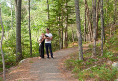 Couple in the woods on a path Royalty Free Stock Photos