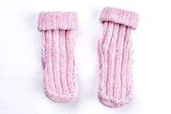 Couple of wool knitted pink socks. Pair of natural wool knitted socks on white background. Soft handmade winter socks for kids Royalty Free Stock Images