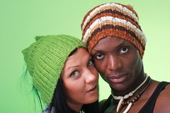 Couple in woollen caps Royalty Free Stock Photography