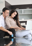Couple work on laptop computer at modern home Stock Photo