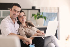 Couple Work On Laptop Computer At Modern Home Stock Image