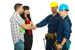 Couple and workers team agreement. Agreement between couple and constructor workers team for renovating a house Stock Photo