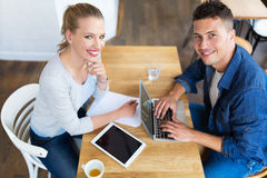 Couple working at cafe. Young couple working at cafe Stock Images