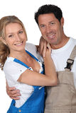 Couple in working clothes Royalty Free Stock Image
