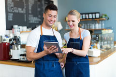Couple working at coffee shop Stock Photography