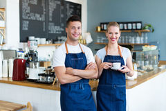 Couple working at coffee shop Royalty Free Stock Photos