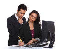 Couple working on a computer Royalty Free Stock Images