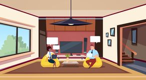 Couple Working On Computers Sit In Bean Bag Chairs In Modern Living Room. Flat Vector Illustration Stock Images