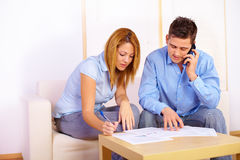 Couple working with documents Stock Photography