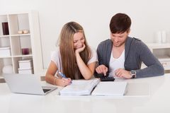 Couple working on expenses Royalty Free Stock Photo
