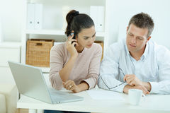 Couple working at home Stock Photo