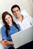 Couple working at home Stock Image