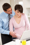 Couple Working From Home Stock Photography