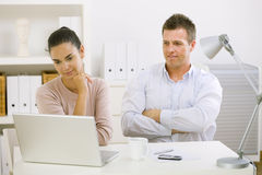 Couple working at home Royalty Free Stock Photos