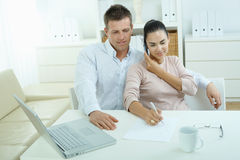 Couple working at home Royalty Free Stock Images