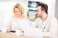Couple working on home budget Stock Images