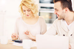 Couple working on home budget Royalty Free Stock Images