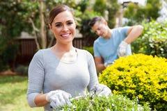 Couple working home garden Stock Image