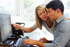 Couple working in home office Royalty Free Stock Photos