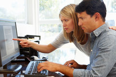 Couple working in home office Royalty Free Stock Images