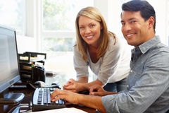 Couple working in home office Stock Photos