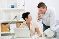 Couple working at home office Stock Photos