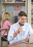 Couple Working In Home Office Together Stock Photo